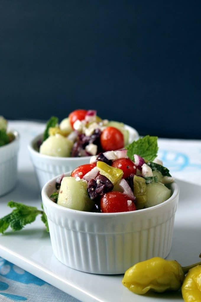 Bite-Sized Greek Salad on a white platter