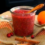 "side view of Cranberry Orange Chia Seed Marmalade in a glass jar with text ""Cranberry Orange Chia Seed Marmalade"""