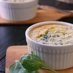 "Side view of Spinach Artichoke Spoon Bread in a ramekin with text ""spinach artichoke spoon bread"""