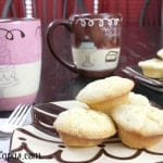 Mini Pound Cake Biteson a multi-colored plate with matching mugs beside it