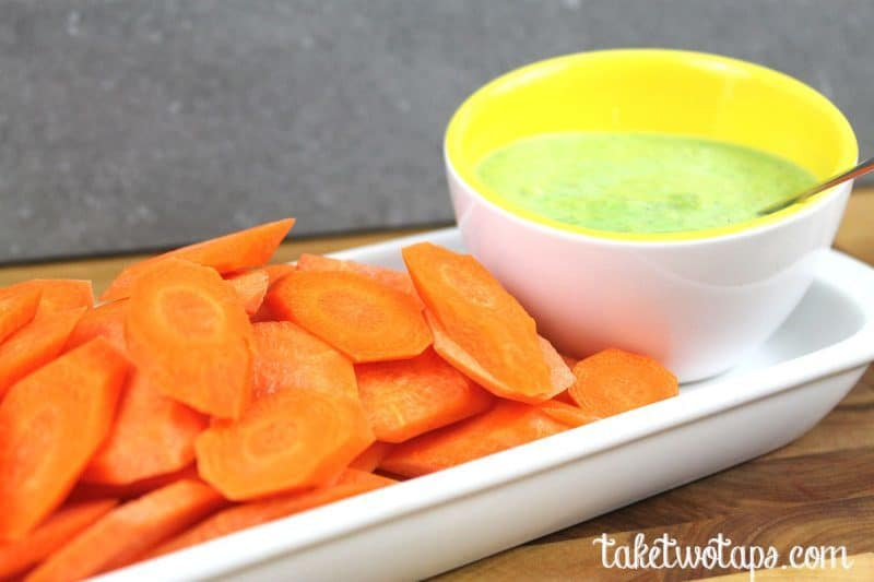 Sweet Pea Dip in a white bowl and Carrot Chips on a white platter