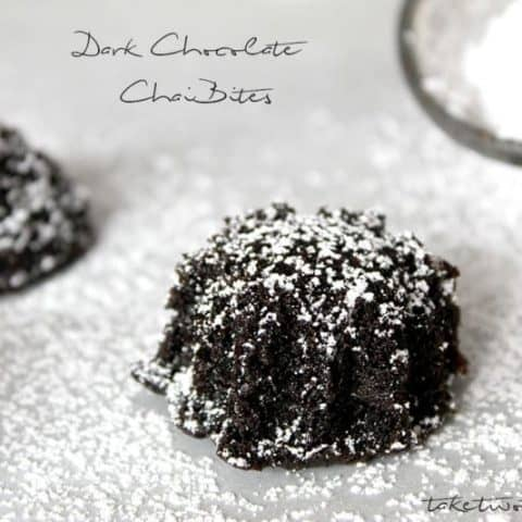 Close up of Dark Chocolate Chai Bites on a platter sprinkled with powdered sugar