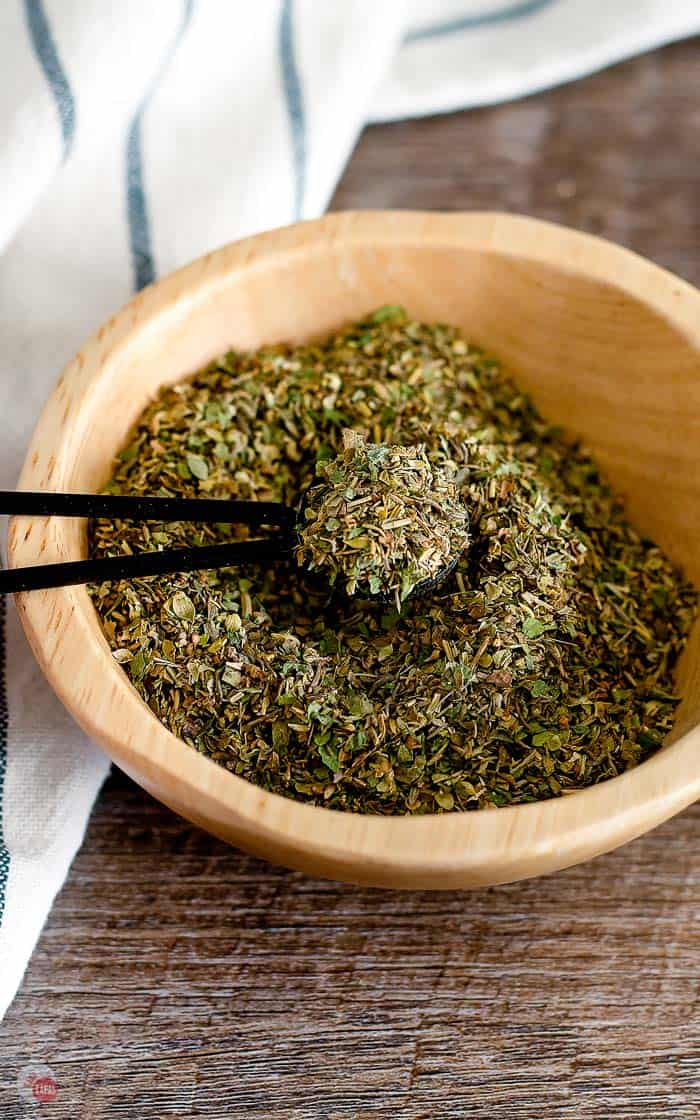 Italian Seasoning being spooned out of a bowl