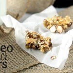 "Paleo Snack Bar with a bite out of it on parchment paper and text ""paleo snack bars"""