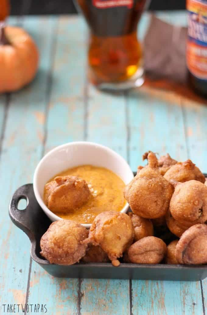 These spicy little andouille sausage corn dog bites are great dipped in mustard and accompanied by your favorite beverage. Great for Game Day! Andouille Corn Dog Bites Recipe | Take Two Tapas