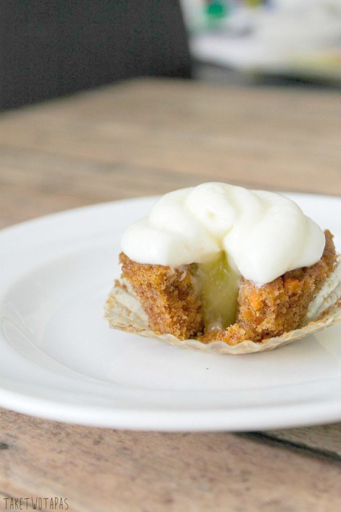 These moist and spicy mini carrot cake cupcakes are the perfect bite with the addition of tart lemon curd and creamy cream cheese frosting! Mini Carrot Cake Cupcakes Recipe with a Surprise | Take Two Tapas