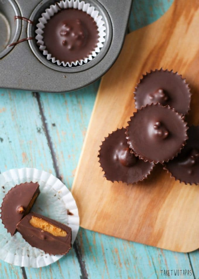 Skip the packaged peanut butter cups in the store and make your own! These peanut butter cups are covered in dark chocolate instead of milk chocolate and have toasted hemp seeds inside for a little crunch. Dark Chocolate Peanut Butter Cups Recipe | Take Two Tapas