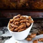 Gingersnap pecans in a bowl on a table