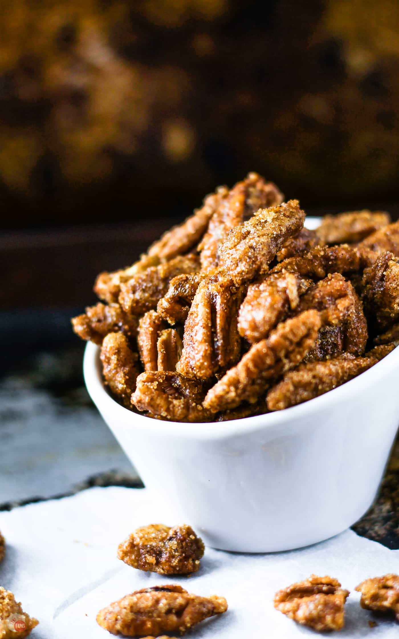 The flavors of you favorite ginger snap cookies and toasted pecans are a great snack. Gingersnap Pecans | Take Two Tapas | #GingerSnaps #GingerRecipes #HolidaySnacks #HolidayRecipes