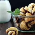 Nutella Mint Rugelach in a glass bowl and one on the table