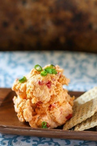 Creamy, cheesy Pimento Cheese Spread is a great party spread! You can make it ahead of time, it keeps for a few days - if it lasts that long, and you can serve it in a bowl or roll it into a cheese ball and sprinkle with toasted pecans! Serve with crackers or on a burger! Pimento Cheese Spread Recipe | Take Two Tapas