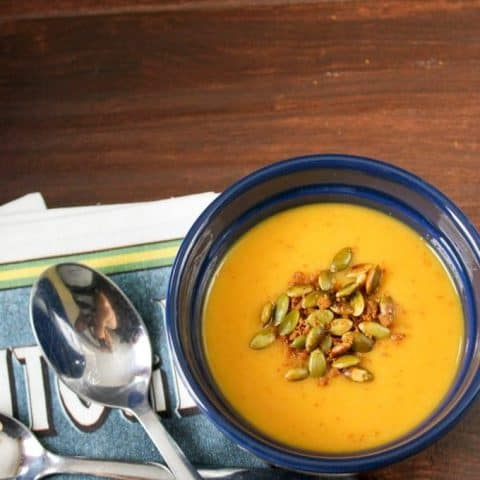 Butternut Squash Soup with Gingersnap Pumpkin Seed Crumble in a bowl