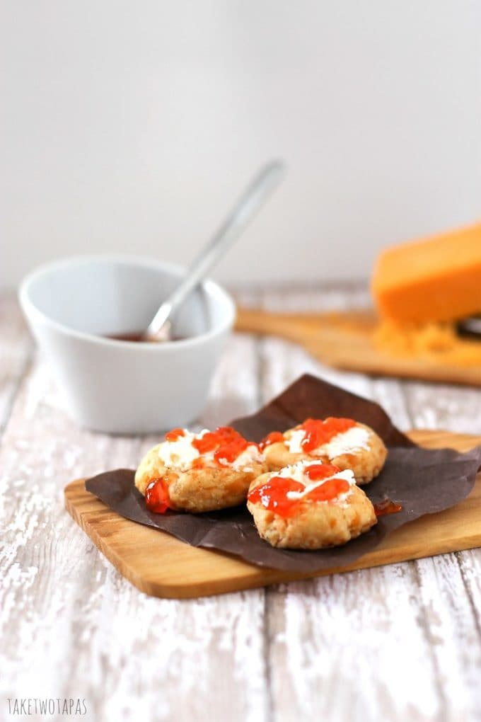 Spicy Cheese Thumbprints with Goat Cheese and Hot Pepper Jelly on a cutting board