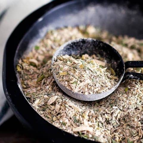 greek seasoning in a bowl with a measuring spoon
