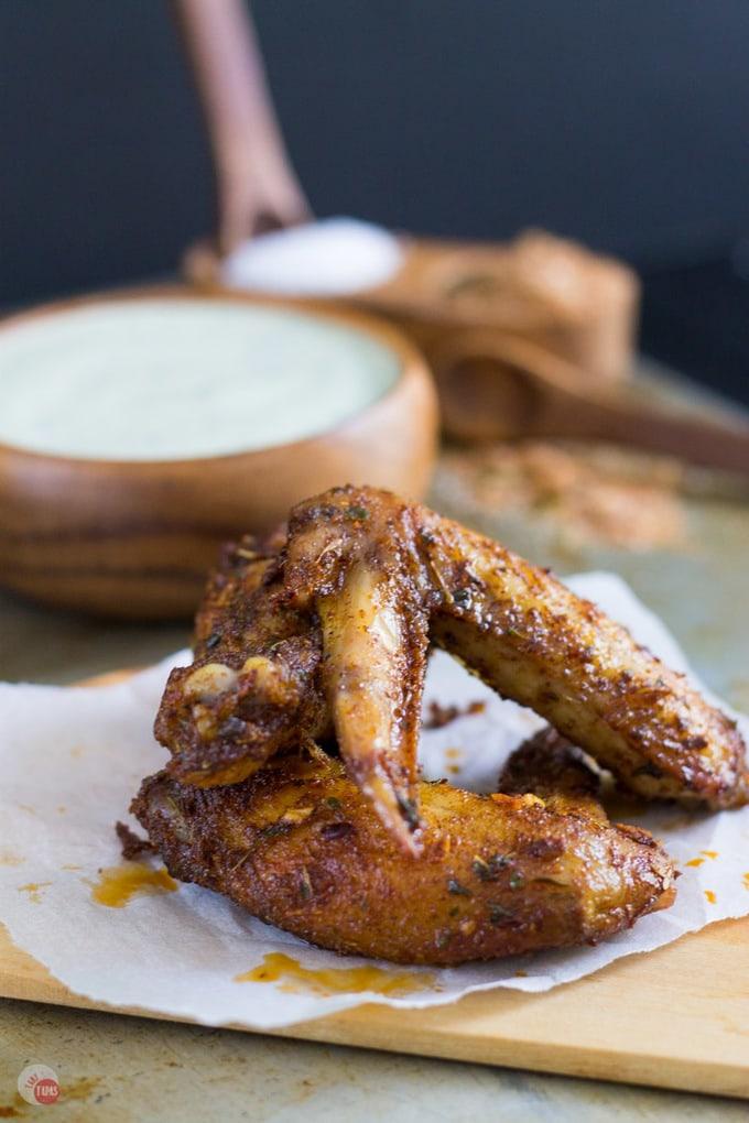 jerk seasoned chicken wings on a cutting board