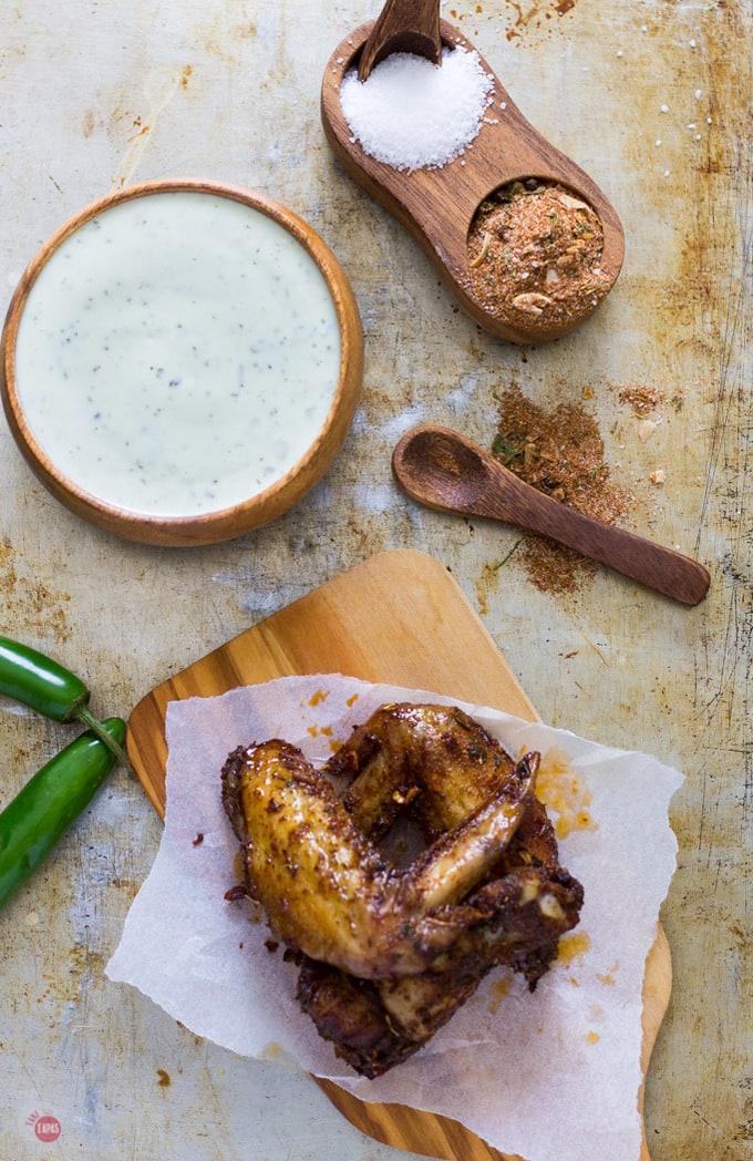 Overhead of Jerk seasoned chicken wings on a cutting board