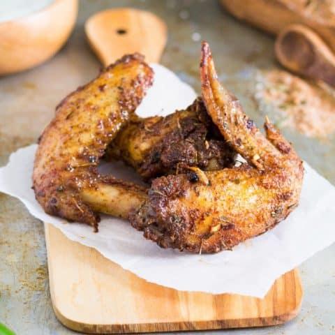 Close up of Jerk seasoned chicken wings on a cutting board