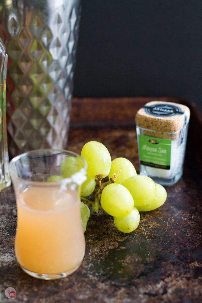 Green Grape Salty Dog Cocktail Shot and green grapes on a wood table