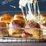 All the yummy ham, pineapple, and all that stretchy cheese! Hawaiian Pizza Sliders Recipe | Take Two Tapas | #HawaiianPizza #Hawaiian #pizza #Sliders #PartyFoods #makeaheadmeals #kidfriendly