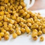 Close up of Pan Roasted Chickpeas spilling on parchment paper
