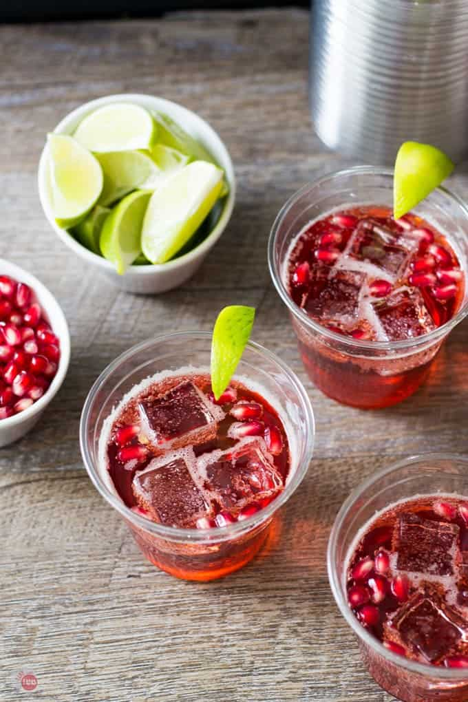 Overhead of cups filled with with pomegranate ginger ale sparkler