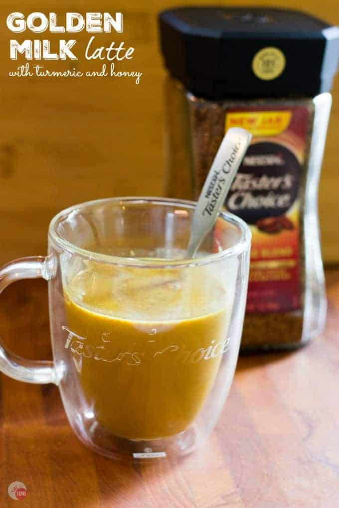 """Side view of latte with text """"Golden Milk latte with Turmeric and honey"""""""