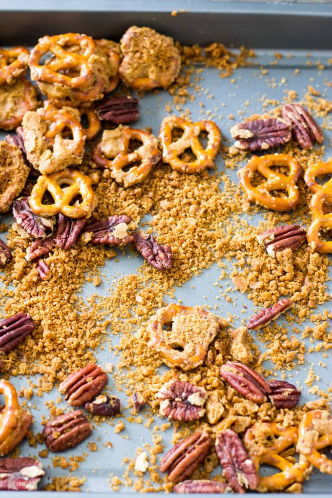 Step up your snack game with pretzels and pecans covered in a crispy caramel coating that is addicting! Crispy Caramel Crack Pretzels Recipe | Take Two Tapas | #CrackPretzels #ToffeePretzels #PretzelCandy