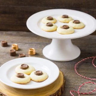The sweetness of a shortbread thumbprint cookie is matched with a caramel Rolo candy and dusted with sea salt! Meet your new favorite cookie exchange member! Salted Rolo Thumbprint Cookie Recipe | Take Two Tapas