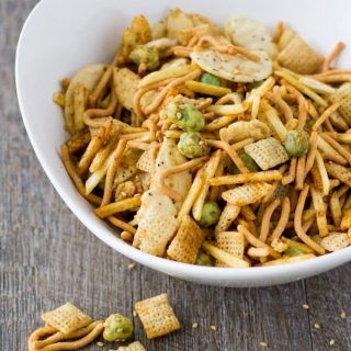 Snack mix takes a trip around the globe and lands in Asian! My Asian Wasabi Chex Mix is loaded with sesame seeds, rice crackers, crunchy chow mein noodles, crispy wasabi peas, and coated with a soy wasabi sauce! Get ready to be addicted to the Far East! Asian Wasabi Chex Mix Recipe | Take Two Tapas