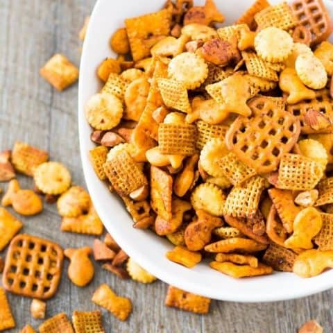 snack mix in a bowl and on the table