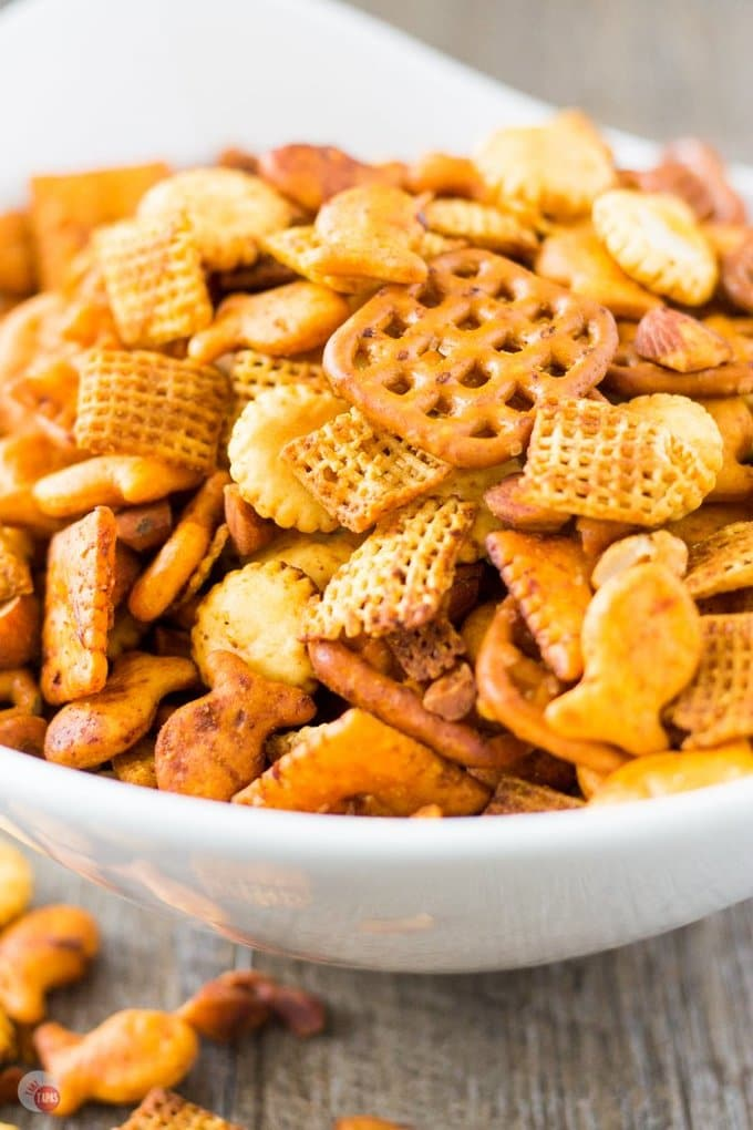 A classic snack mix is spiced up! Sriracha Spicy Chex Mix | Take Two Tapas | #Sriracha #ChexMix #Chex #Snacks #Spicy