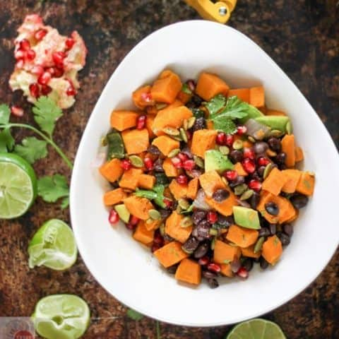 Overhead of Sweet potatoes, black beans, and avocado in a white bowl