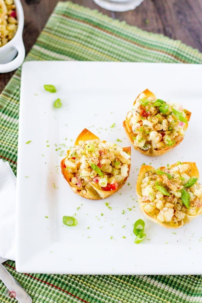 These Mexican Street Corn Salad Wonton Cups displayed from above. | Take Two Tapas | #MexicanStreetCorn #Salad #Wonton #StreetCorn #CincodeMayo