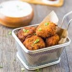 Mashed Potatoes are mixed with Southwest seasoning and fried to a crispy golden brown. Served with a spicy cool green chile ranch dip and they are the perfect appetizer! Southwest Potato Croquettes with Green Chile Ranch Dip Recipe | Take Two Tapas | #Southwest #PotatoCroquette #MashedPotatoes #PotatoRecipe #Appetizer #GreenChilies #RanchDip