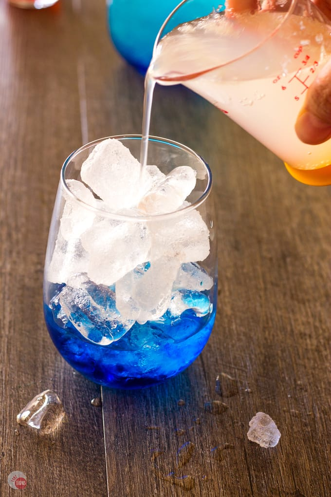 Pour your Space Pop Cocktail slowly | Take Two Tapas | #PatrioticRecipes #4thofJuly #RedWhiteBlue #CocktailRecipes #VodkaRecipe #SummerHolidays #SummerRecipes