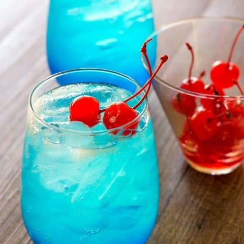 Space Pop Cocktail with Cherries on a wood surface