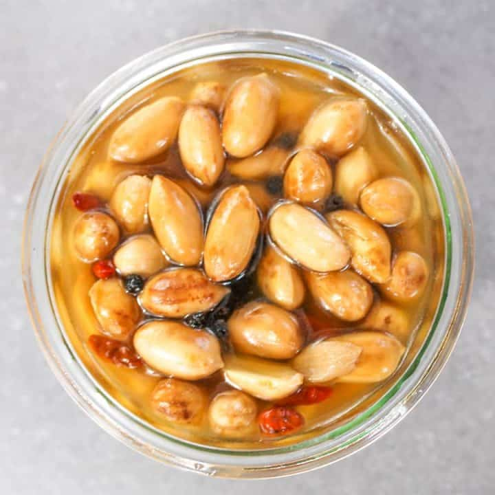 Overhead close up of Pickled Boiled Peanuts in a glass jar