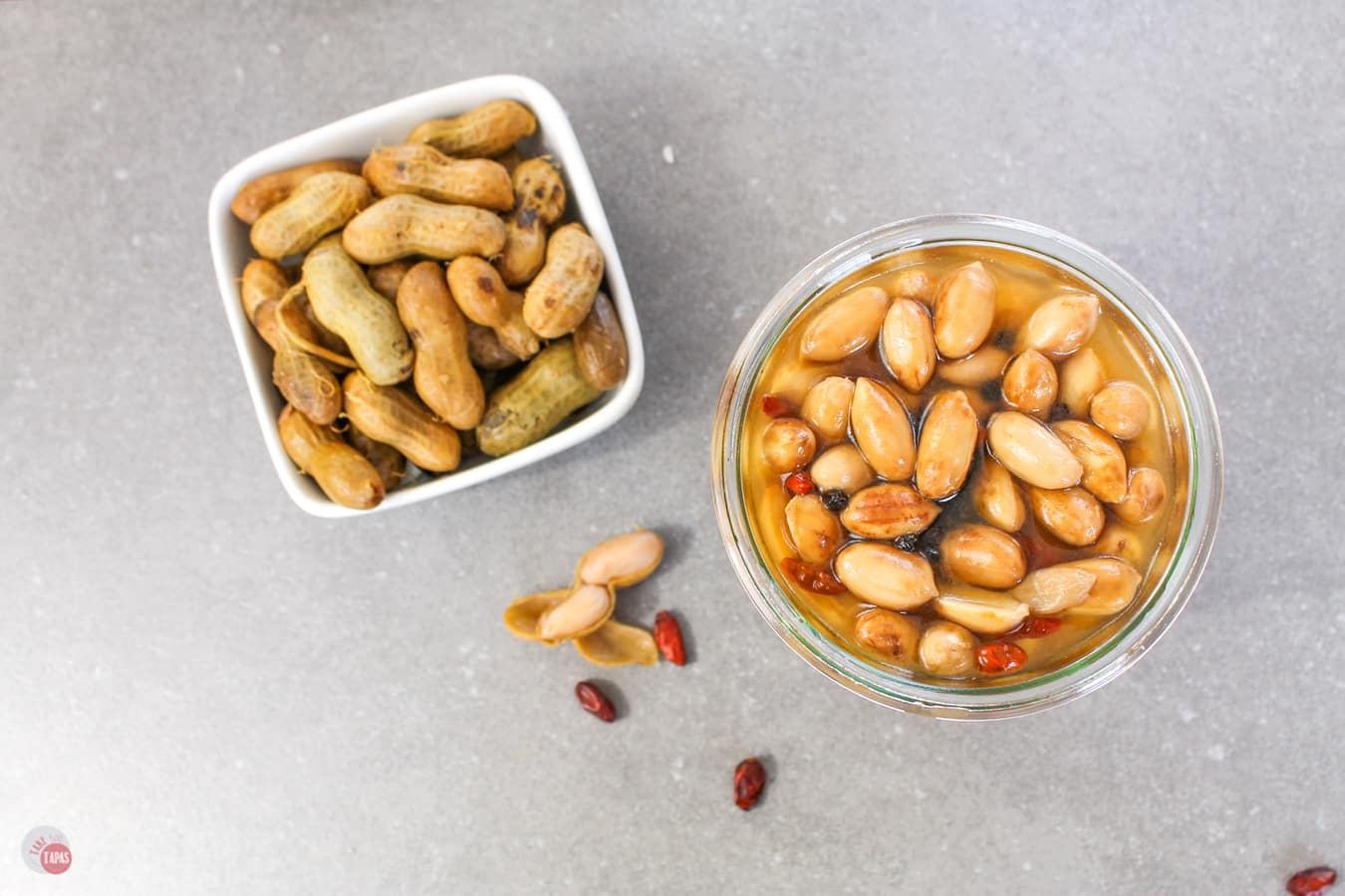 pickled nuts in a jar in the shell and out of the shell
