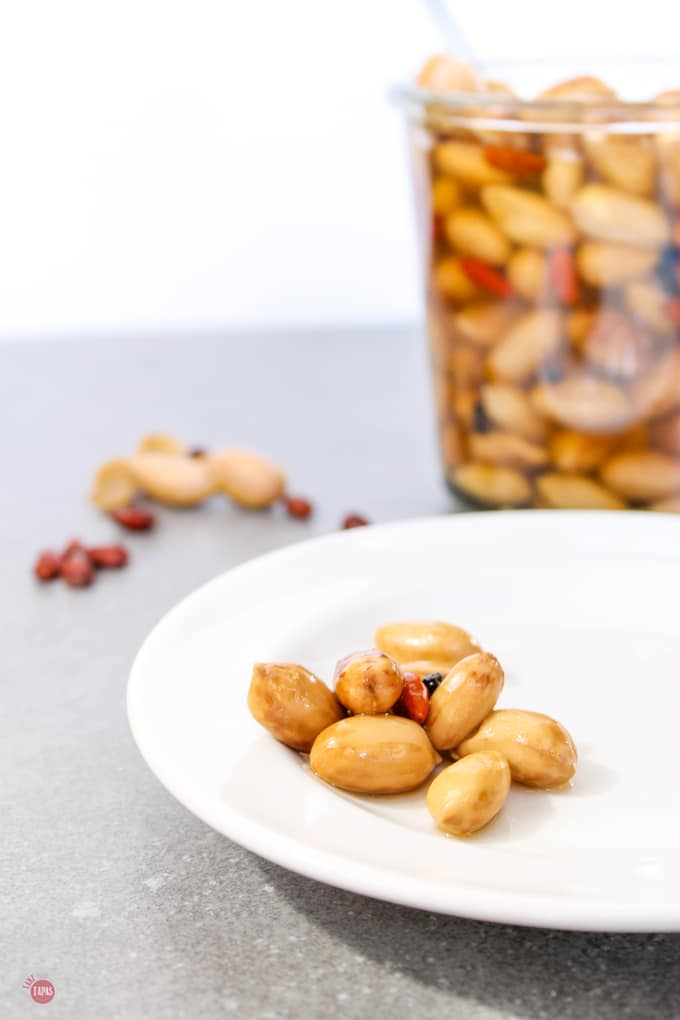 pickled boiled peanuts on a white plate