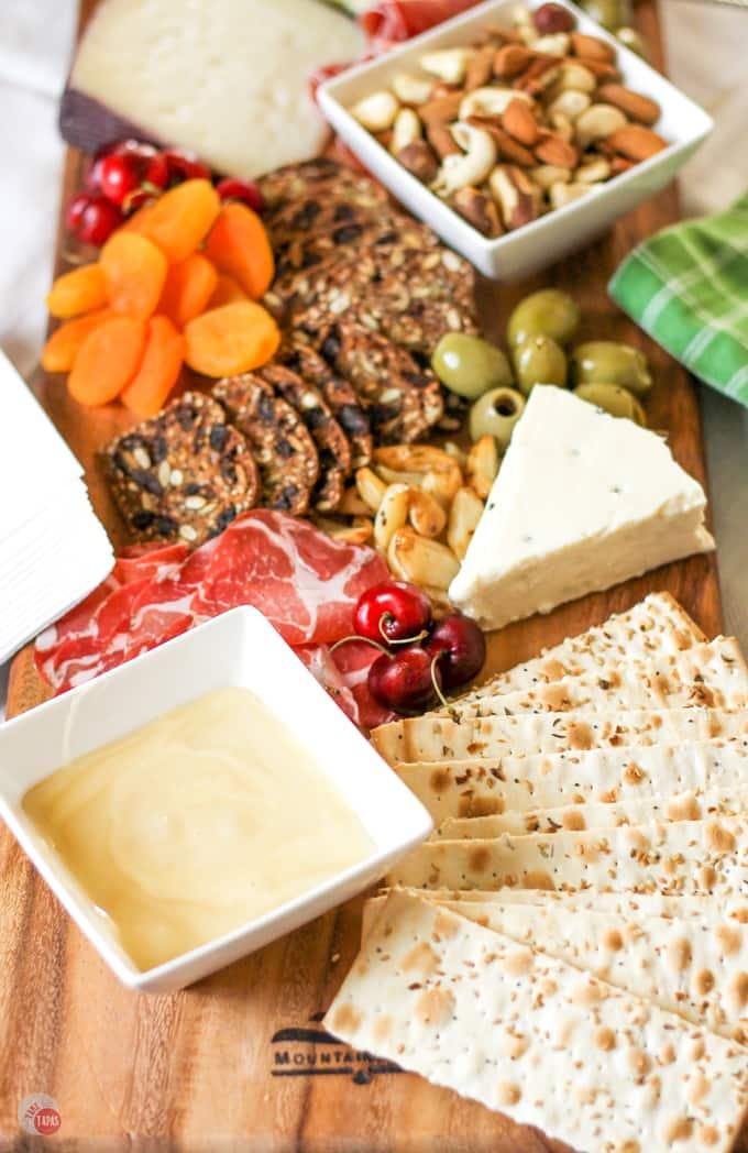 Graze on a Summer Tapas Antipasto Cheese Board   Take Two Tapas   #SummerEntertaining #EasyEntertaining #CheeseBoardIdeas #CheeseBoardDisplay #Antipasto #Tapas #CheeseBoard
