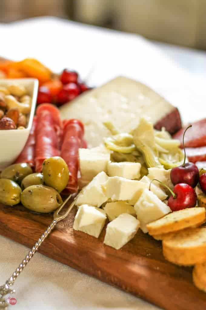 Grab some cheese on this summer tapas antipasto cheese board | Take Two Tapas | #SummerEntertaining #EasyEntertaining #CheeseBoardIdeas #CheeseBoardDisplay #Antipasto #Tapas #CheeseBoard