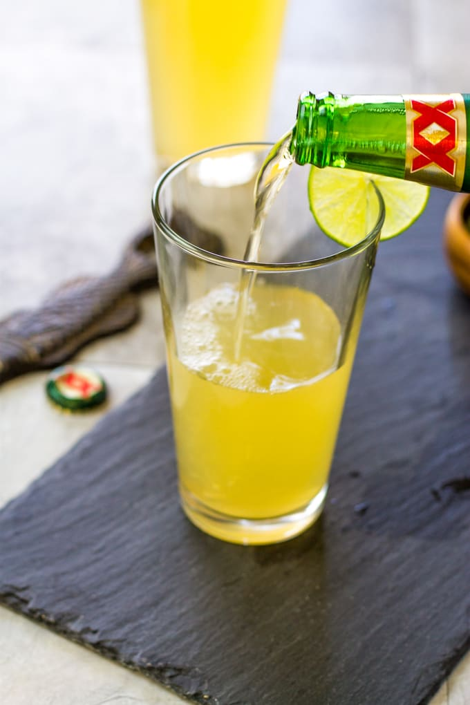 Add the beer to your limeade and tequila mixture. Margarita Beer Shandy Cocktail | Take Two Tapas | #margarita #beer #Shandy #cocktails