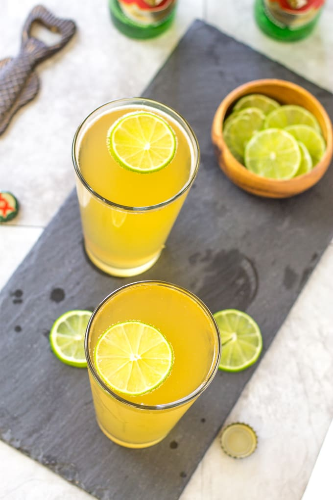 Float a lime wheel on top of the Margarita Beer Shandy | Take Two Tapas | #margarita #beer #Shandy #cocktails