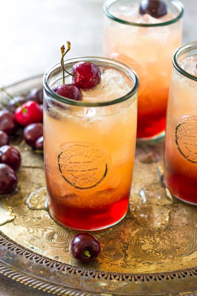 side angle of cherry amaretto cocktails
