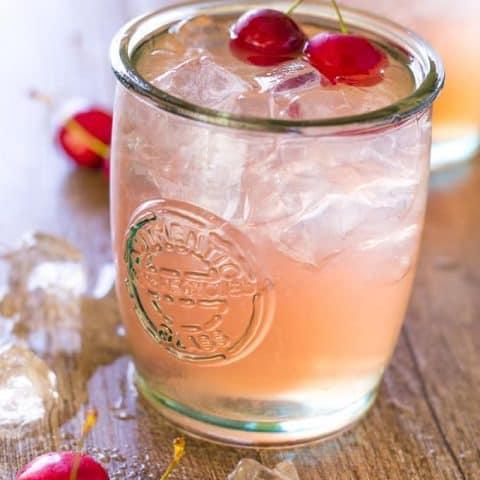 Close up of Cherry Lime Bourbon Smash Cocktail