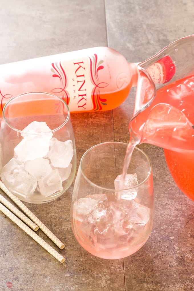 Pouring the Pink Passion Party Punch in to glasses