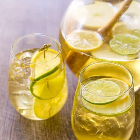 Summer Apple Sangria in 2 glasses and a glass pitcher