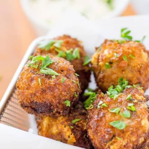 Fried Bacon Manchego Croquettes in a paper lined fry basket