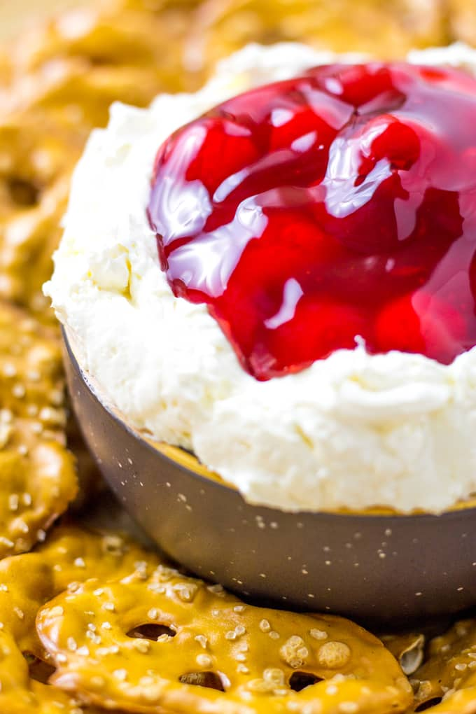 Top with tart cherry pie filling to make this Cherry Pretzel Salad Dip | Take Two Tapas | #Cherry #Pretzel #Salad #Cheesecake #DipRecipe #SweetDipRecipe #Strawberry