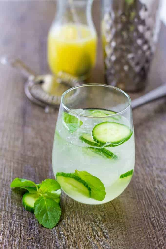 Herbaceous Cucumber Mint Gin Cooler with lime sparkling water